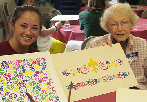 Camryn Jung (left) and Barbara Kay show off their creations at Artfest 2015.