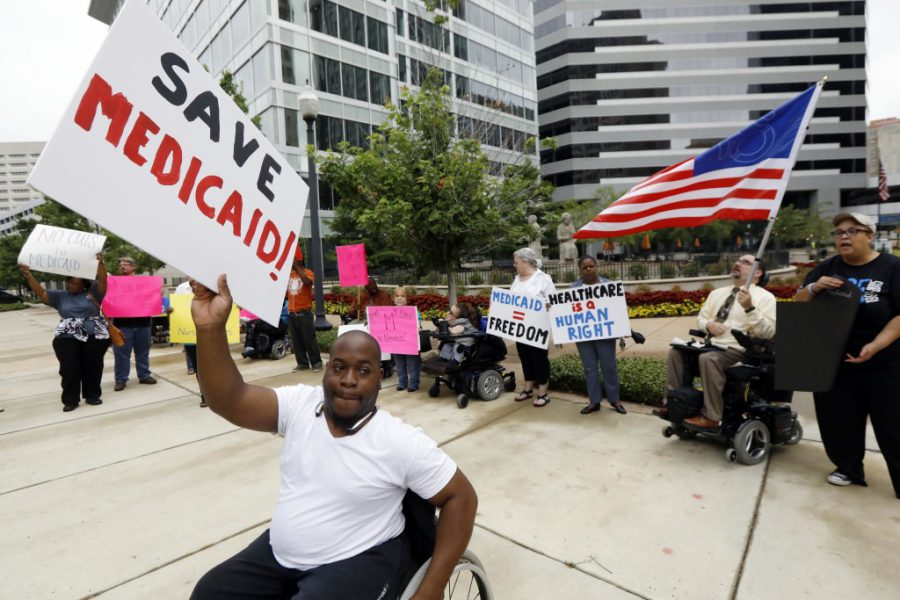 People with disabilities and their supporters protesting proposed Medicaid spending cuts in Washington, D.C.